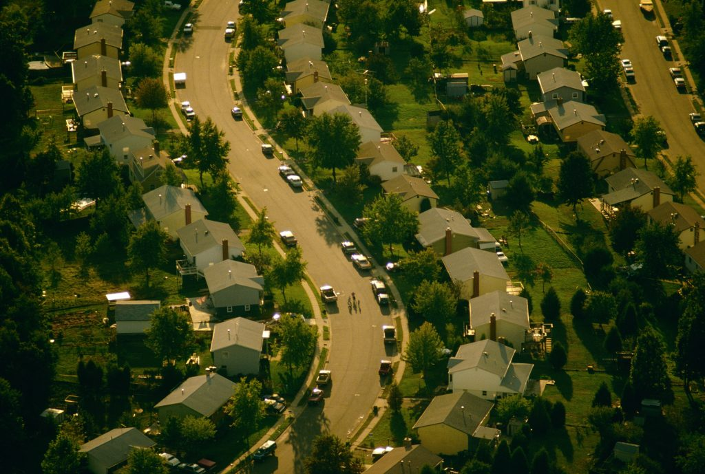 Aerial view of winding suburban road to illustrate Homeowners Association (HOA) Right to Hearing